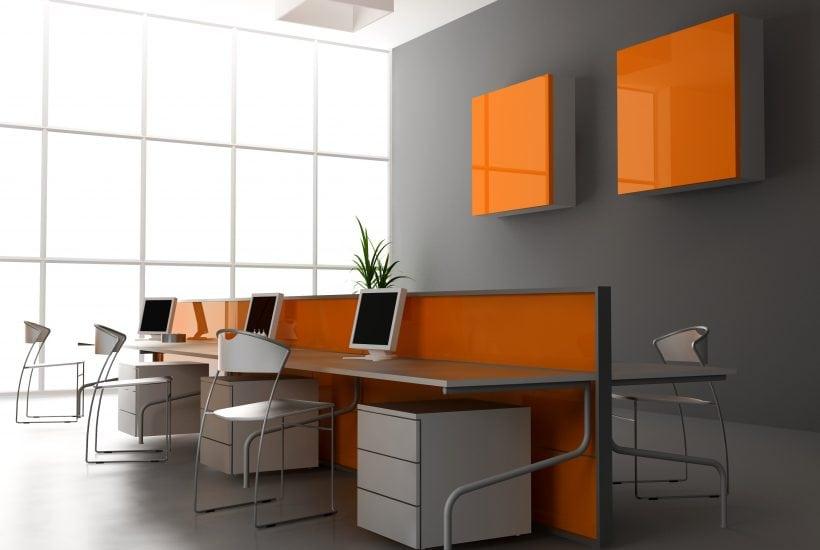 wellness architecture modern office with shared desk grey walls orange artwork plants windows