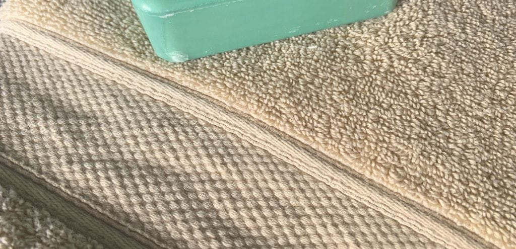 Grund America organic cotton bath towel driftwood color with green bar of soap
