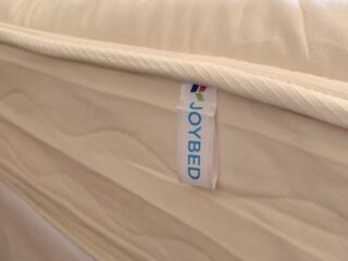 joybed mattress tag on natural bed