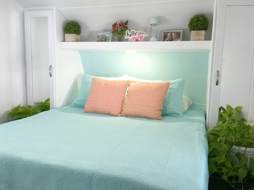RV Mattress in bedroom with blue comforter