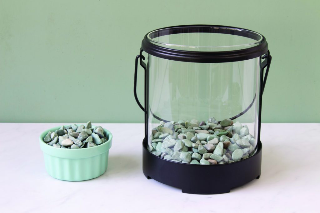 glass lantern filled with pebbles for terrarium