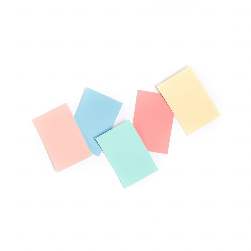 paint sample chips in a variety of colors against white background
