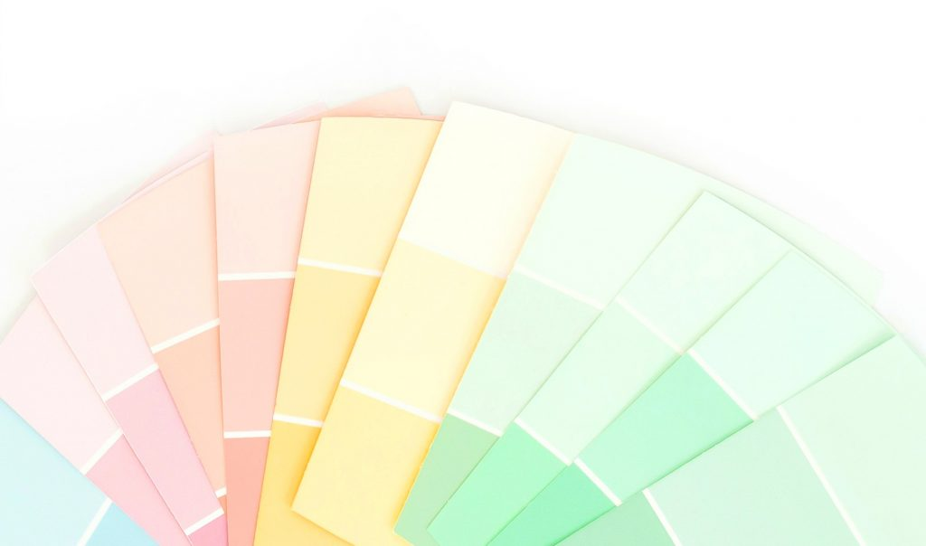 paint samples in pastel colors against white background