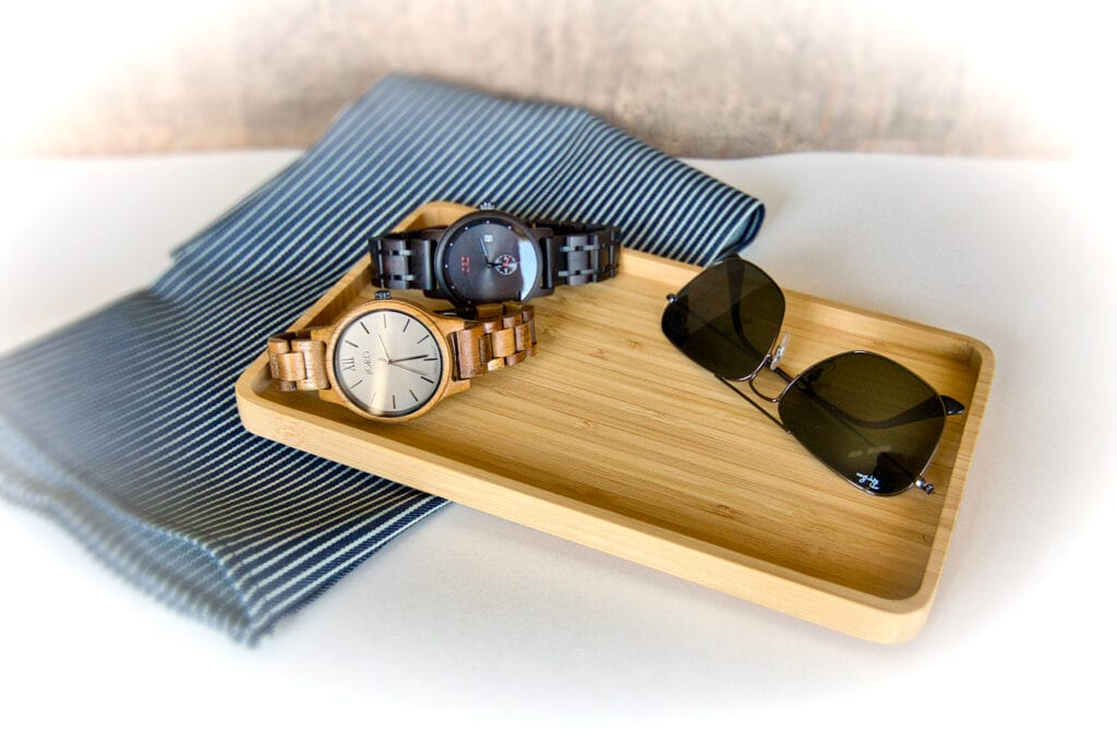bamboo tray holding mens objects