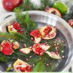 Christmas stovetop potpourri with pine needles pomegranate lime in steel pot