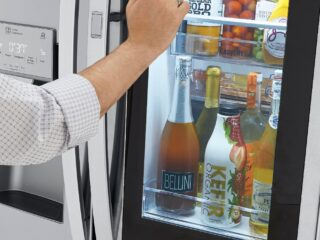 woman knocking on glass door of LG InstaView Door-in-Door Refrigerator