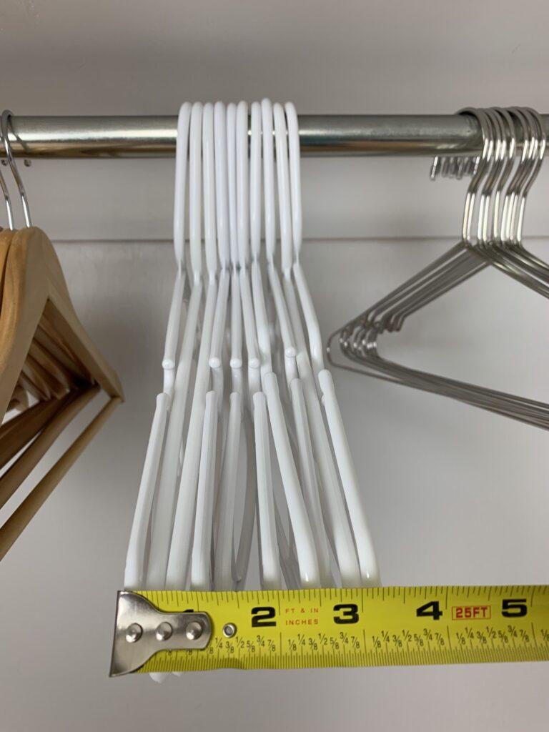 white plastic hangers in closet
