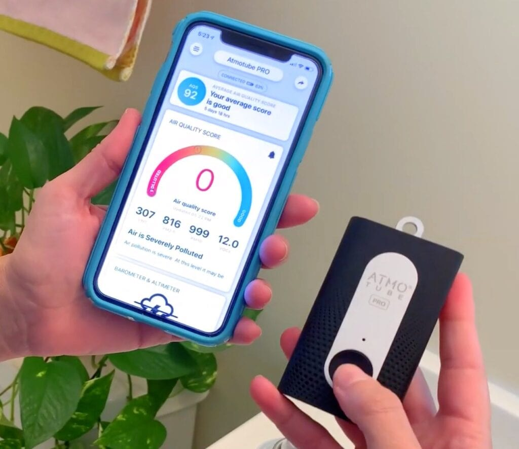 Atmotube air quality monitor in hand