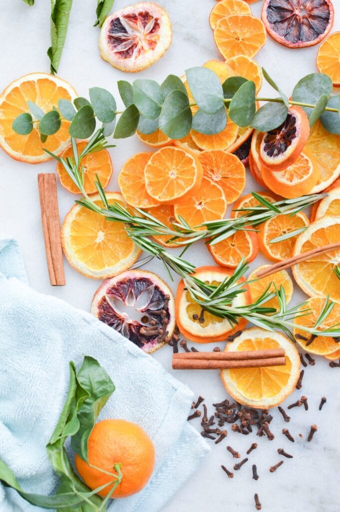 oranges eucalyptus rosemary cloves on marble background