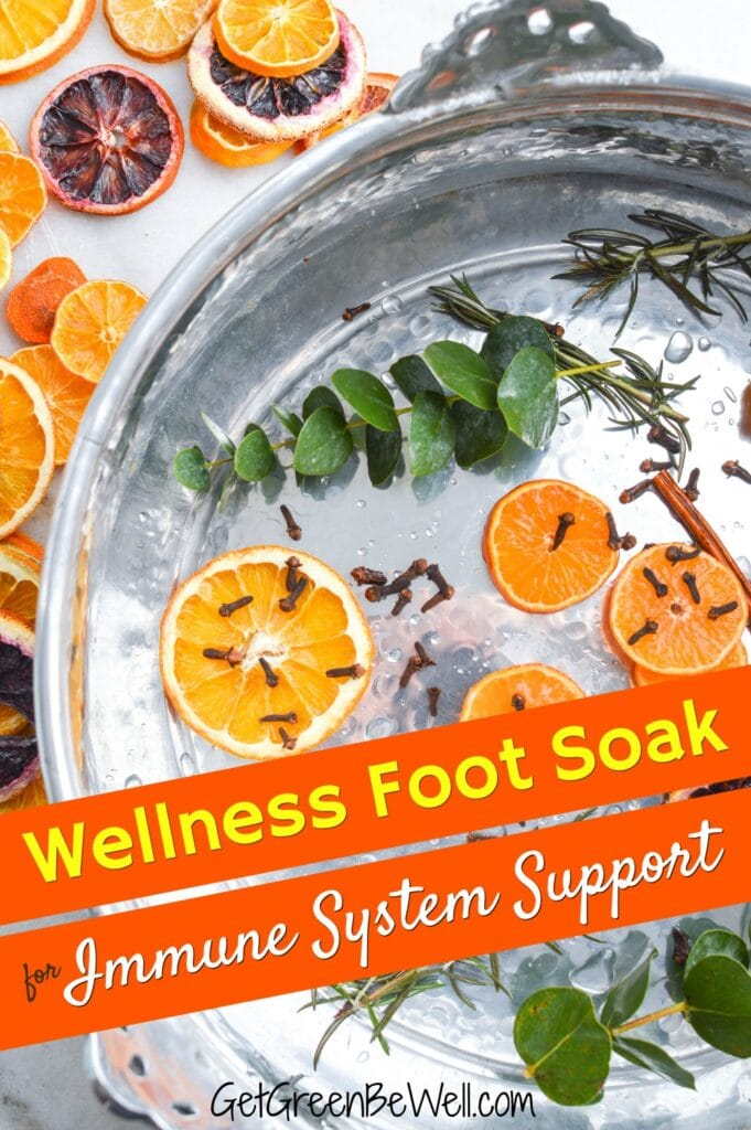 foot soak basin filled with oranges and herbs
