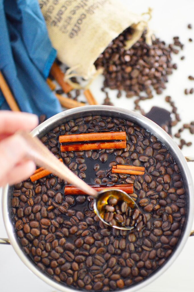 coffee smell air freshener in pot with coffee beans and cinnamon sticks