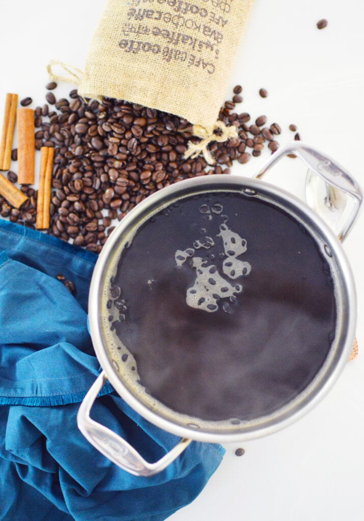 coffee smell air freshener simmering in pot with whole coffee beans