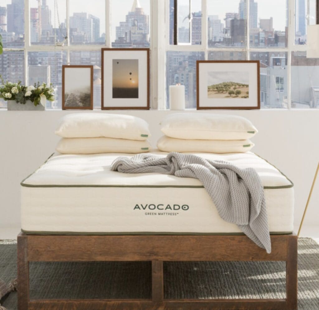 avocado green mattress sustainable wood bed frame with mattress on top
