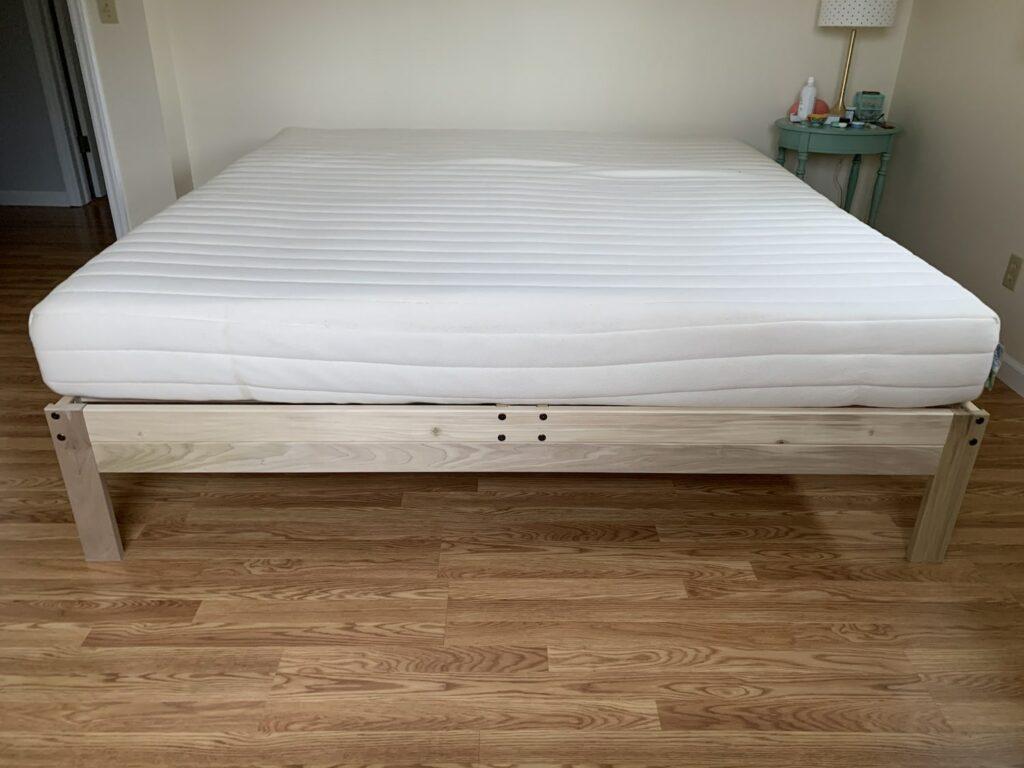 mattress on solid wood platform bed frame