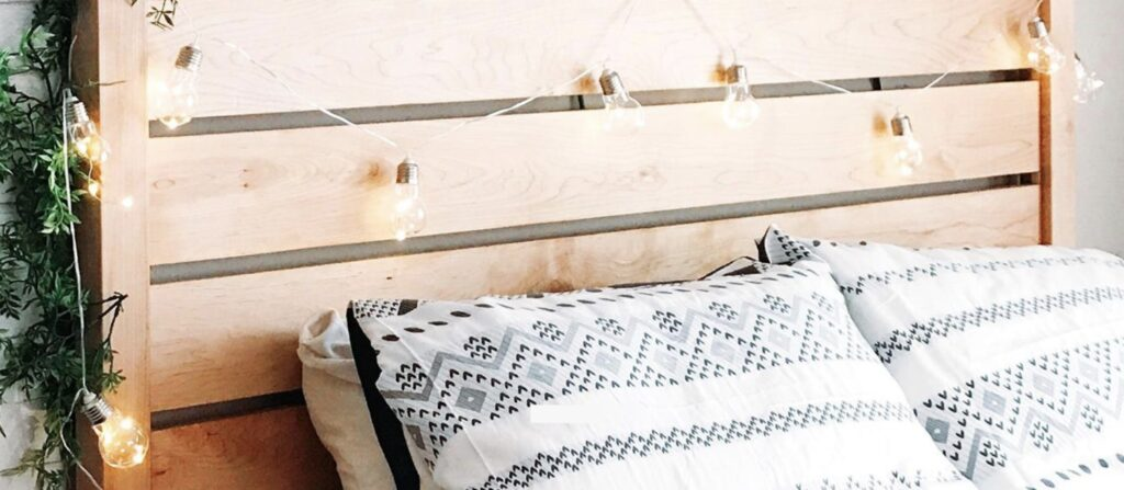 wooden slat headboard on hardwood bed frame