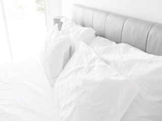 white bed pillows on white sheets
