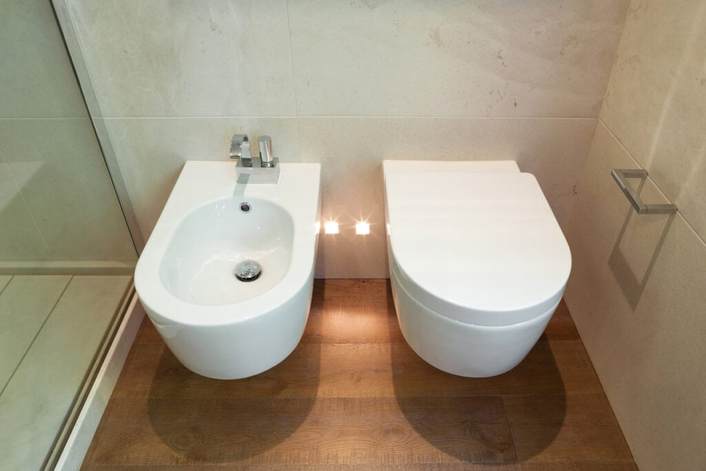 white toilet and bidet in bathroom