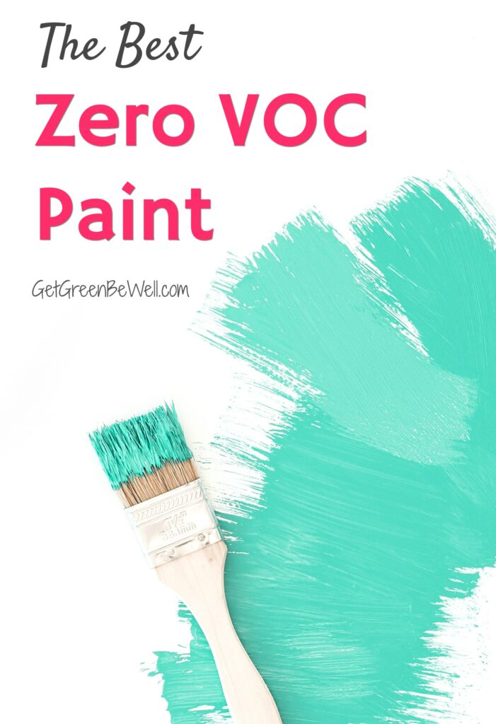 green paint on white wall with paint brush nearby