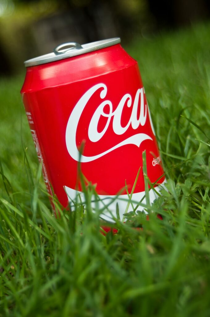 red Coke can in green grass