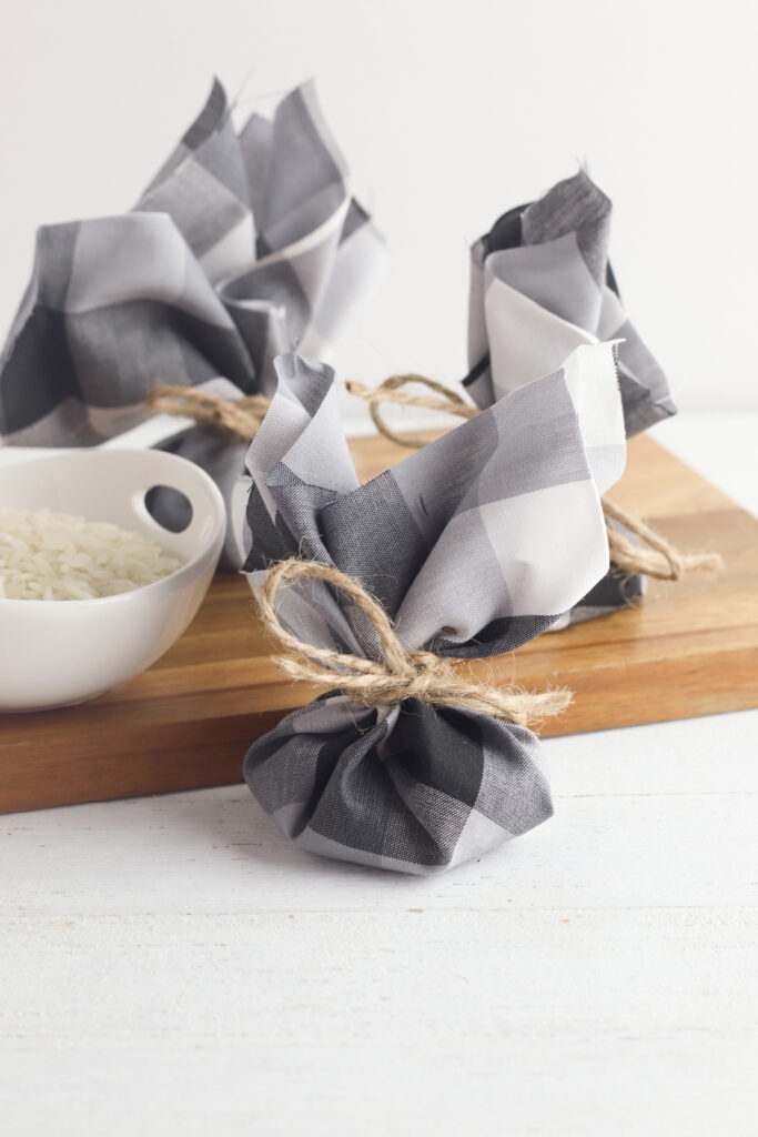 bowl of rice on wooden cutting board with dresser sachets