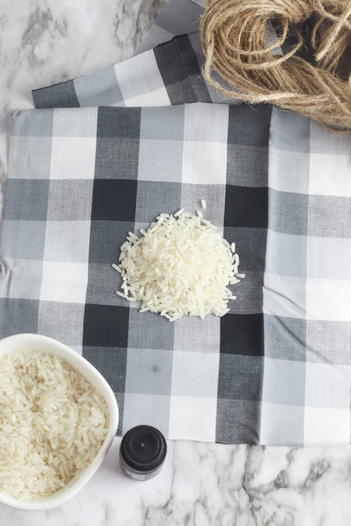 white rice on black plaid fabric with twine in a pile nearby