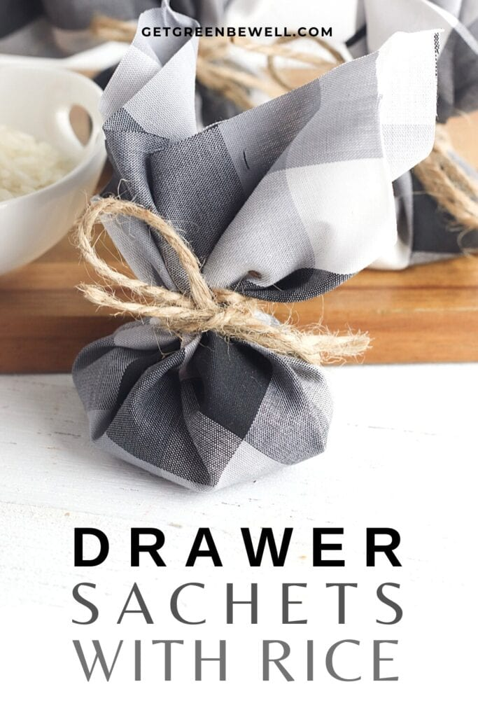 drawer sachet tied with twine on white surface with wooden cutting board behind