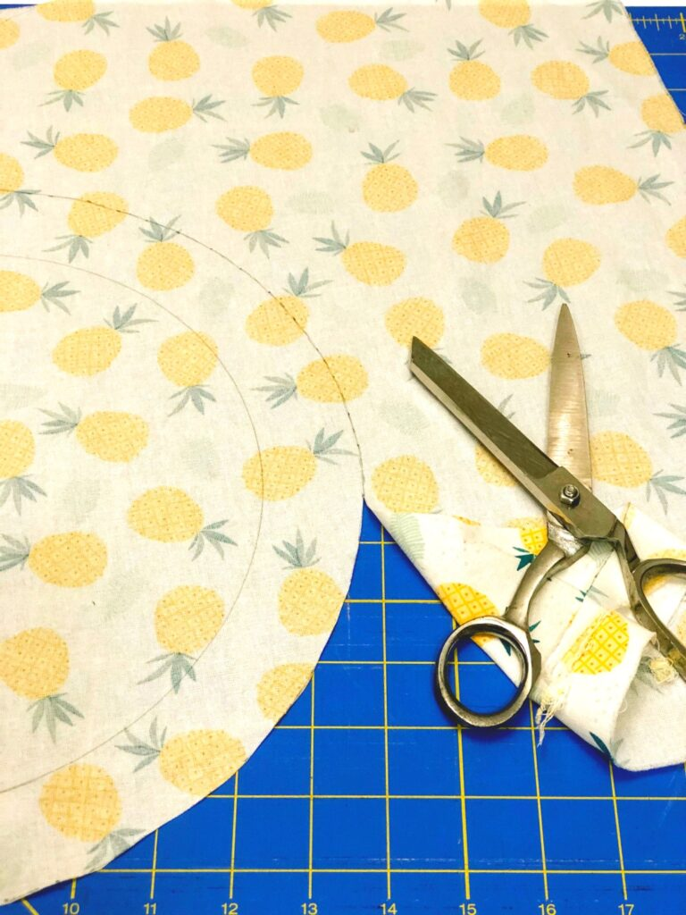 fabric cut into a circle with scissors nearby