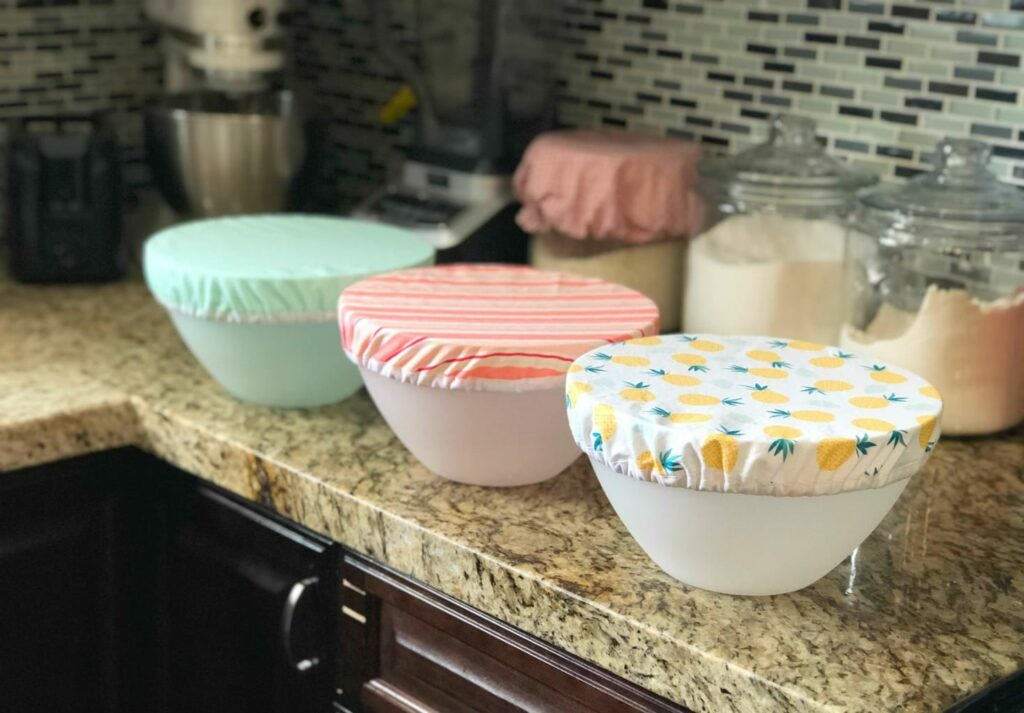 reusable fabric bowl covers on plastic bowls on kitchen countertop