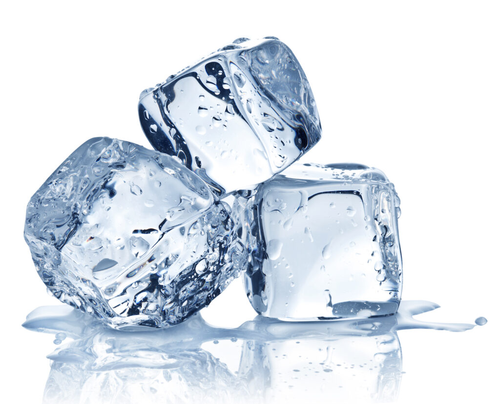 three ice cubes stacked against white background