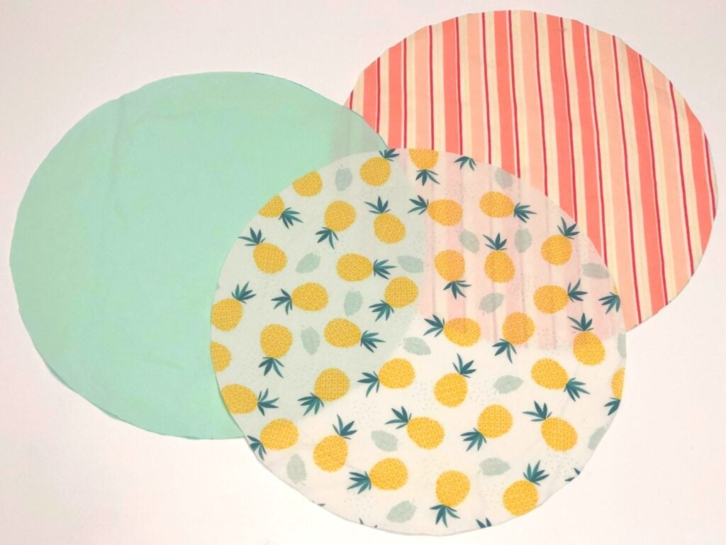 three fabric circles laying on white background