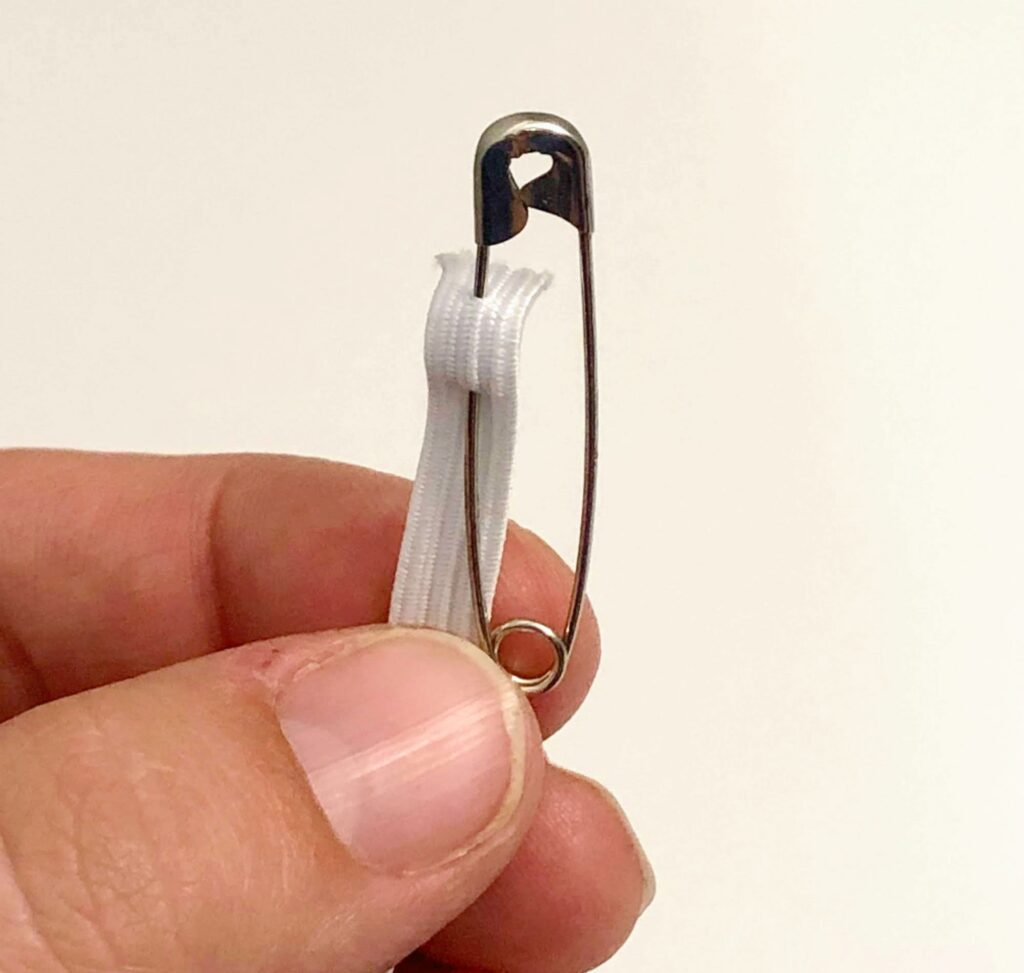 safety pin attached to elastic
