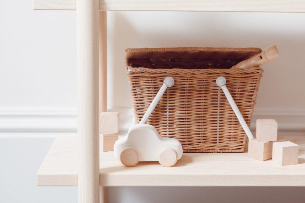 wicker basket with kids toys on a shelf