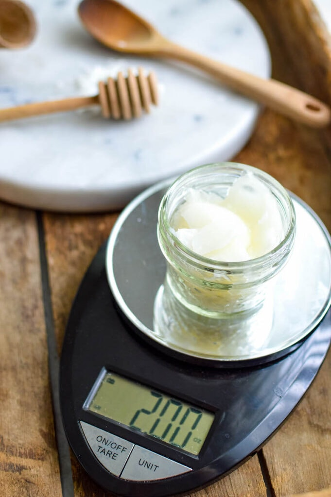jar of beeswax on kitchen scale
