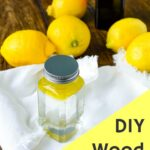 wood cleaner in glass jar surrounded by lemons