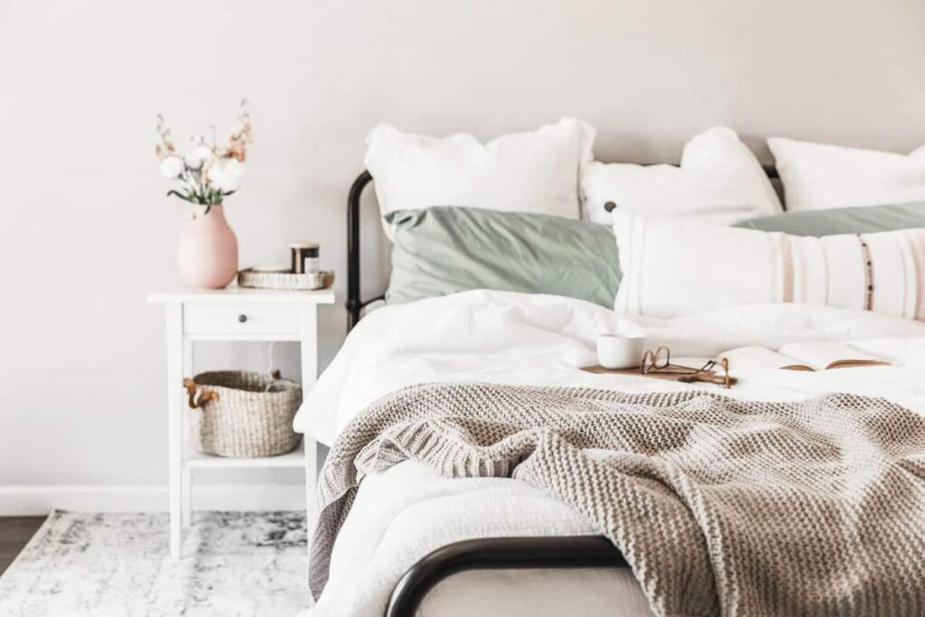 bed with lots of pillows in a bedroom
