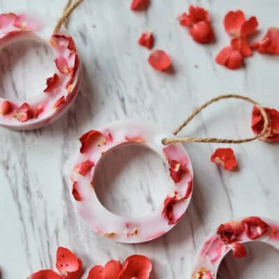 hanging wax circles with dried rose petals