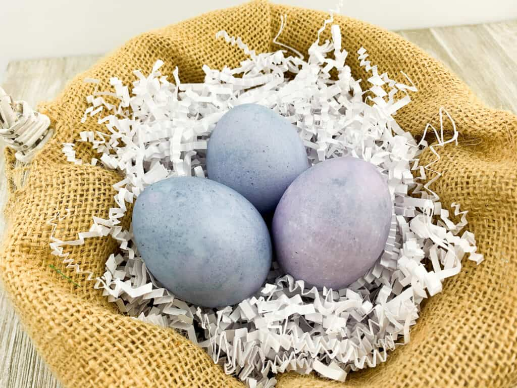 Blueberry Dyed Egg in basket with burlap