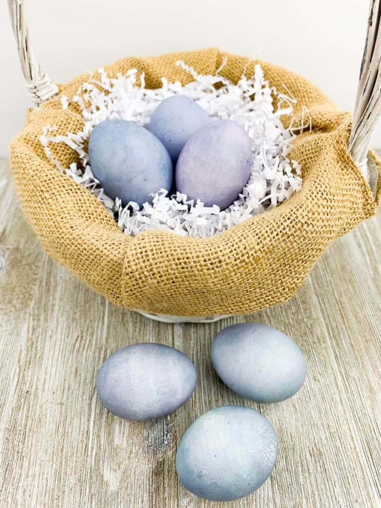 Blueberry Dyed Egg in basket and on wood table