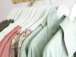 shirts on hangers hanging on clothing rack