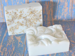 yarrow soaps on blue weathered wood background