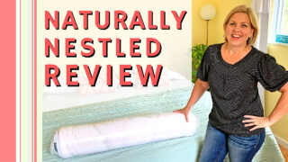 woman standing by naturally nestled latex mattress topper