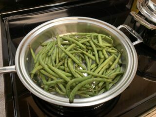 green beans in a stainless steel pan